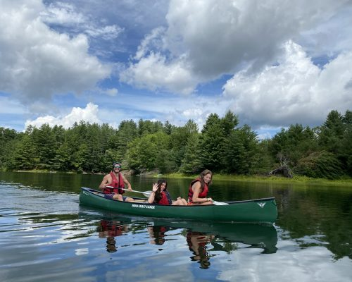 students canoeing during outdoor adventure