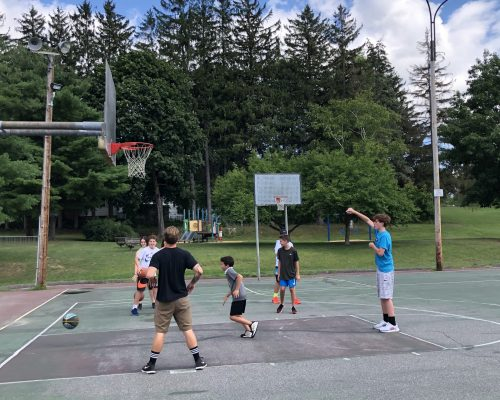 Students playing basketball at Burlington, Vermont Pre-College Summer Program