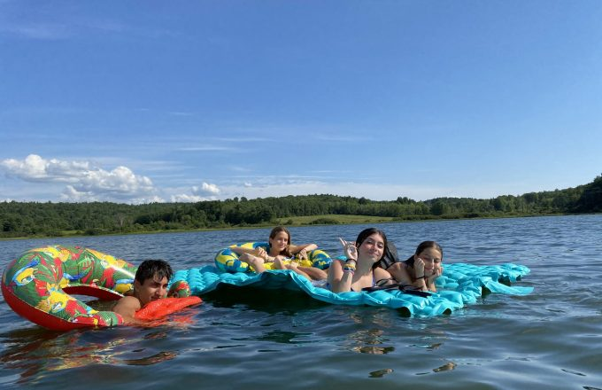 students enjoying the lake