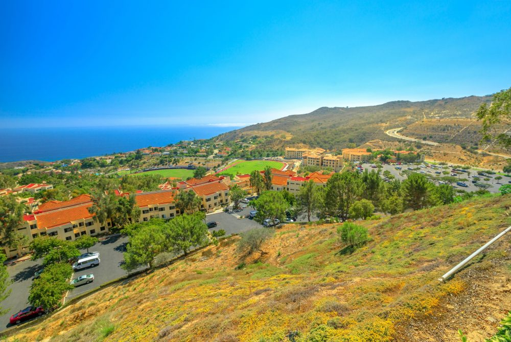 Scenic landscape of Pacific Coast in California. Panoramic aerial view of Pepperdine University, an American university in Malibu, Unites States. The campus on the hills overlooking the Pacific Ocean.