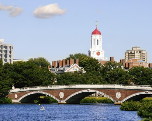 View of Harvard University and pedestrian bridge on Charles River in Cambridge, Massachusetts