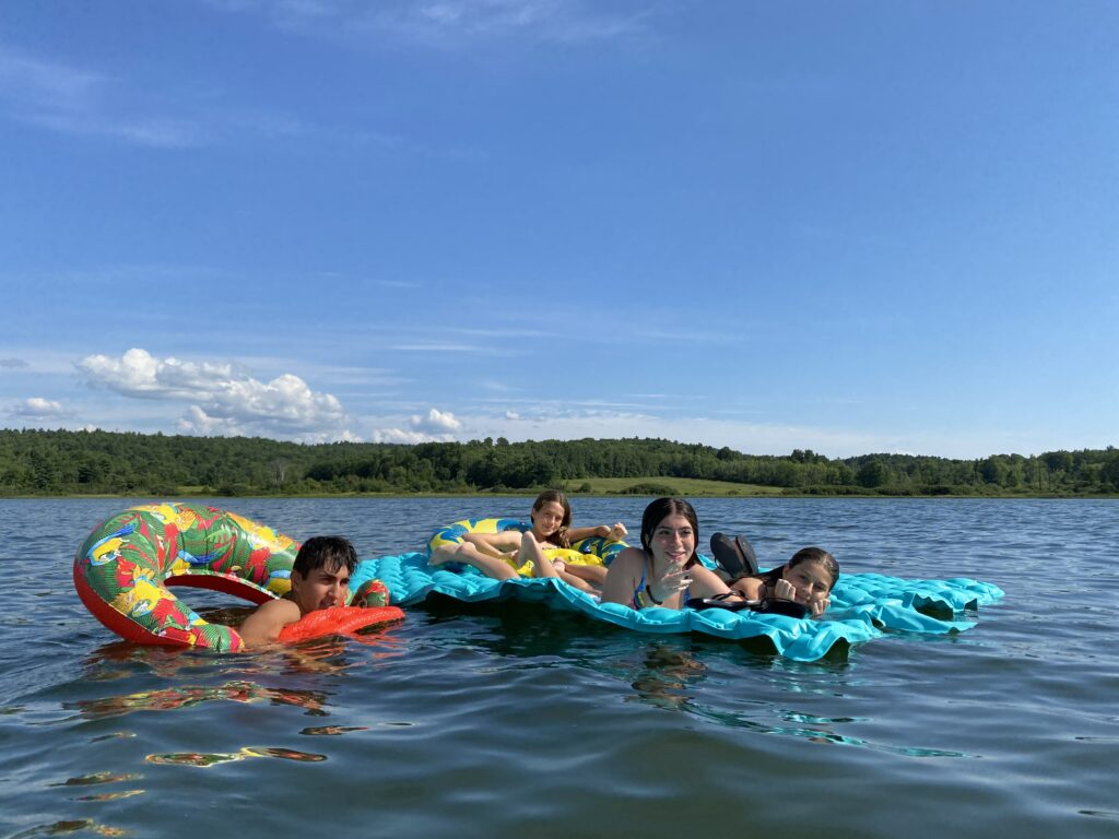 students on rafts in lake